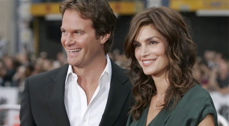 Cindy Crawford and Rande Gerber on a red carpet.