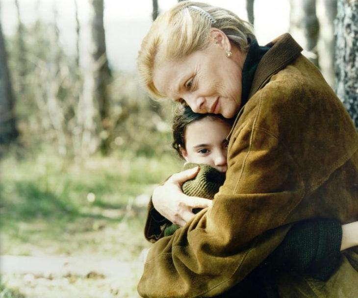 woman girl hugging grandmother
