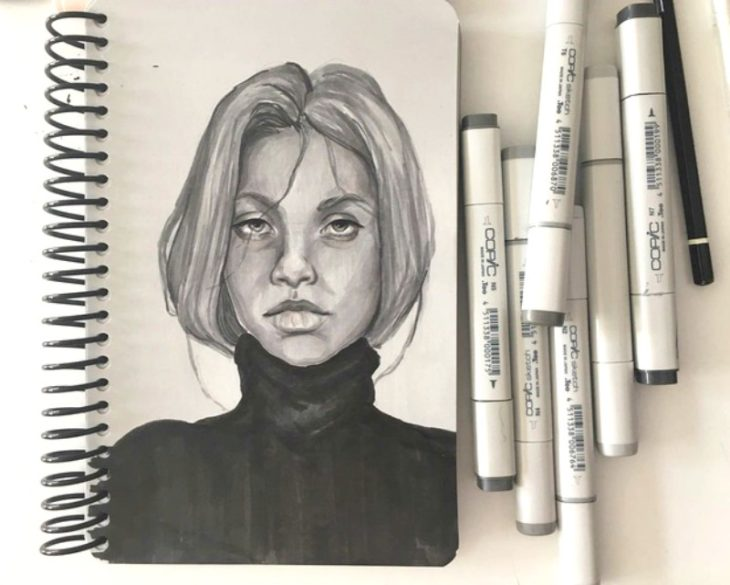 woman drawing with markers