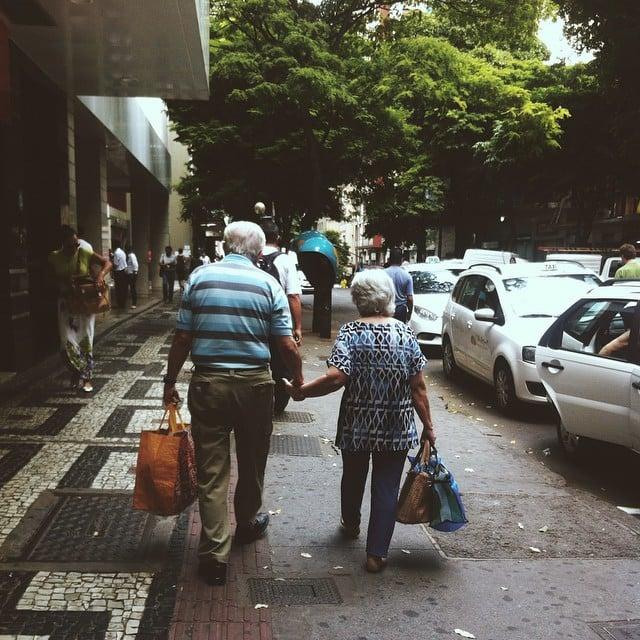 elderly women and men walking on the street