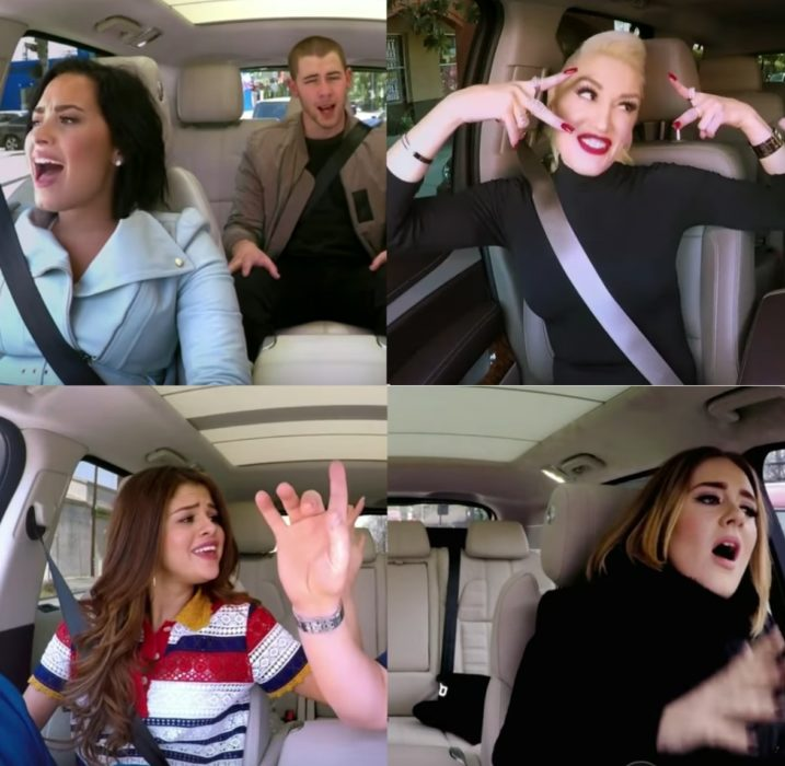 Men and women singing in a car