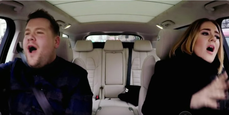 Blond woman with blond man singing in the car