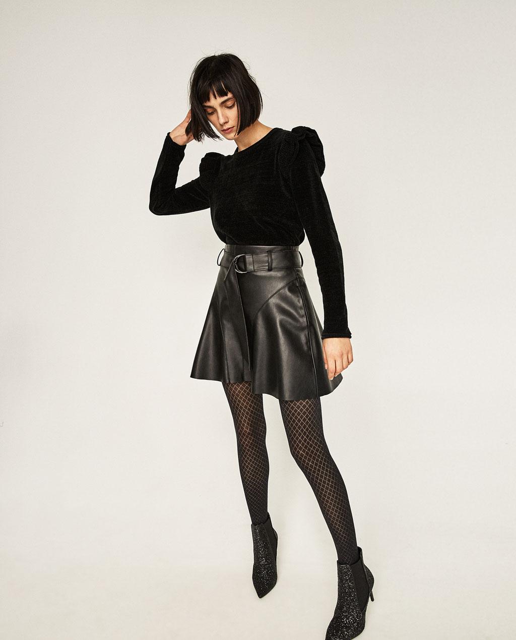 9db8e7a2ae Escoge faldas de colores oscuros para que te ayuden a estilizar tu cuerpo y  disimulen mejor tu vientre.
