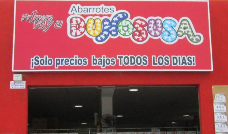 tienda de abarrotes con letrero rojo