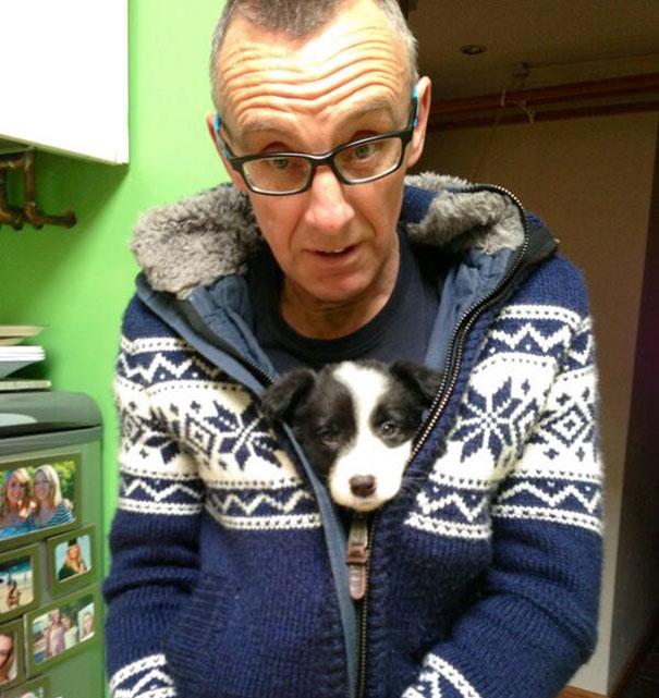 Hombre abrazando a su perro