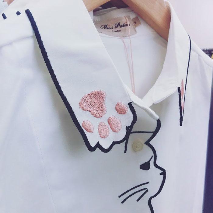 camisa con cuello de gato