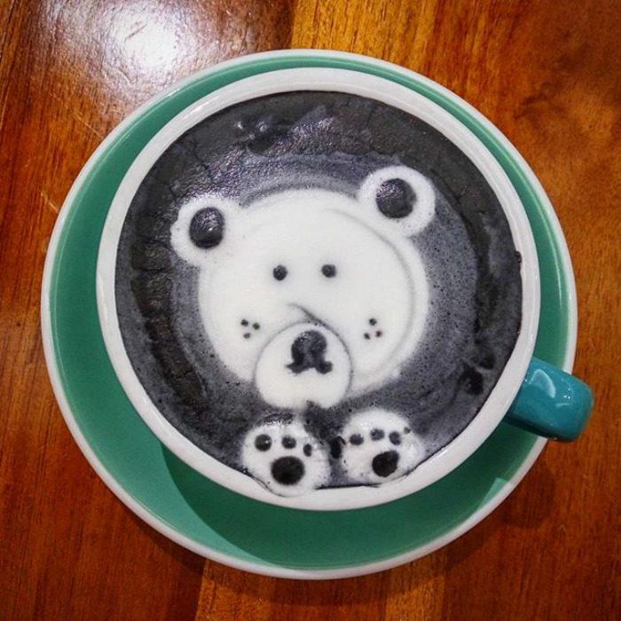 tazas de café negras con oso