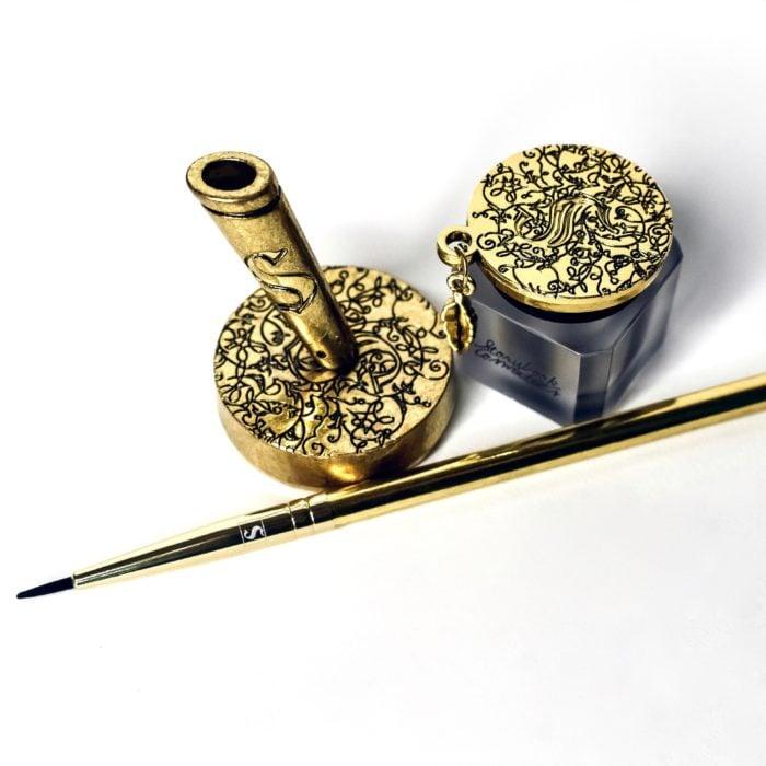 pluma y tintero de harry potter