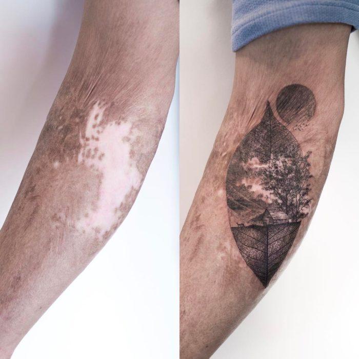 Tatuaje en forma de hoja con una luna