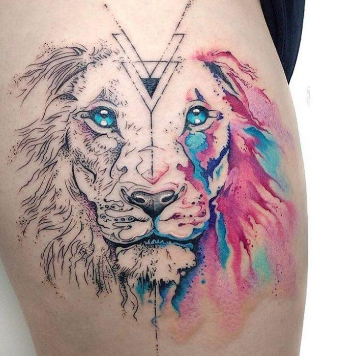 tatuaje de león con cara partida