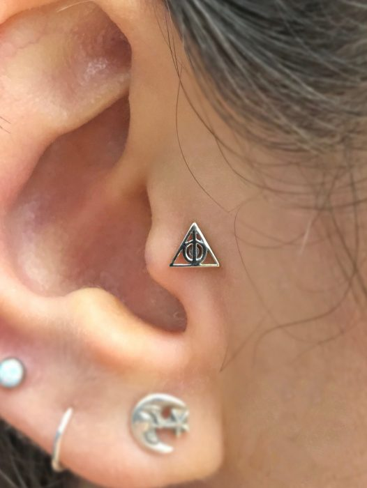 Girl wearing a Tragus Piercing