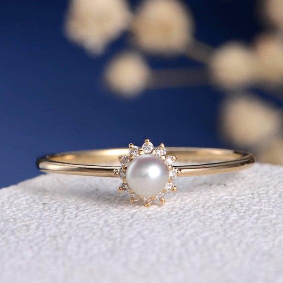 anillo de perla con diamantes
