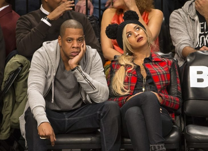 Jay Z and wife Beyonce attend the Brooklyn Nets vs Philadelphia 76ers game with Super Bowl Champion Seattle Seahawks quarterback Russell Wilson