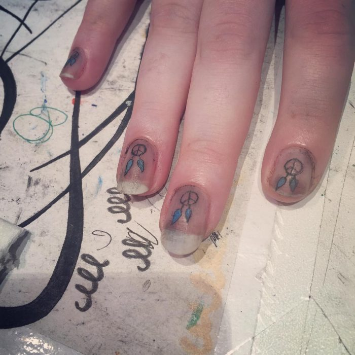 fingernail tattoos