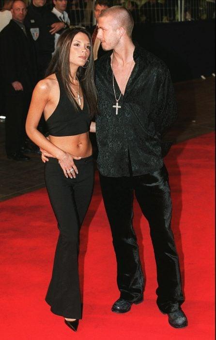 Victoria Beckham junto a David Beckham