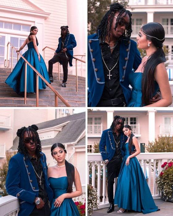 Chico vestido con un traje azul y chica usando un vestido azul
