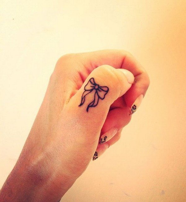 Tattoo of a bun on the thumb