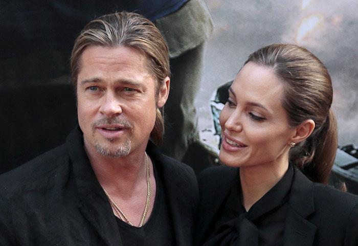 Angelina Jolie y Brad Pitt en una alfombra roja
