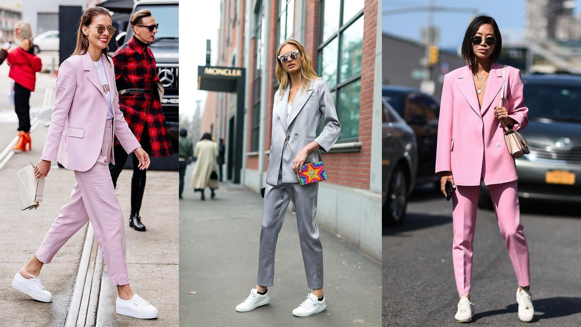 Chica usando un traje de color gris y otra con traje color rosa
