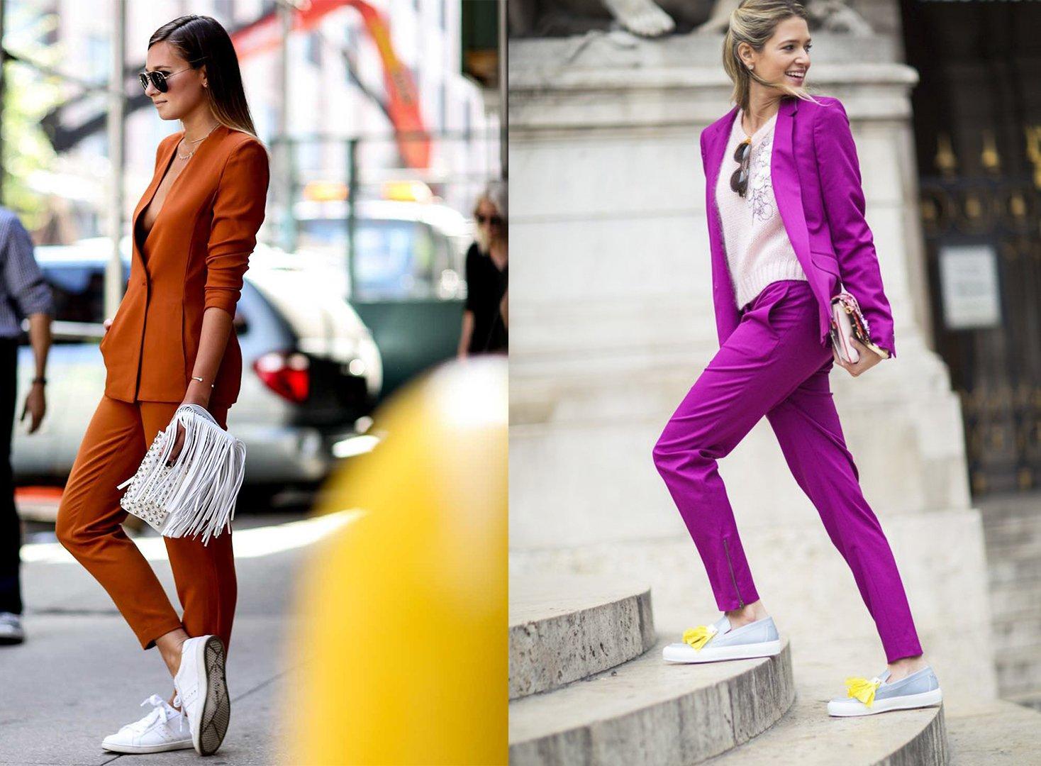 Chica usando un traje color fucsia y la otra un traje naranja
