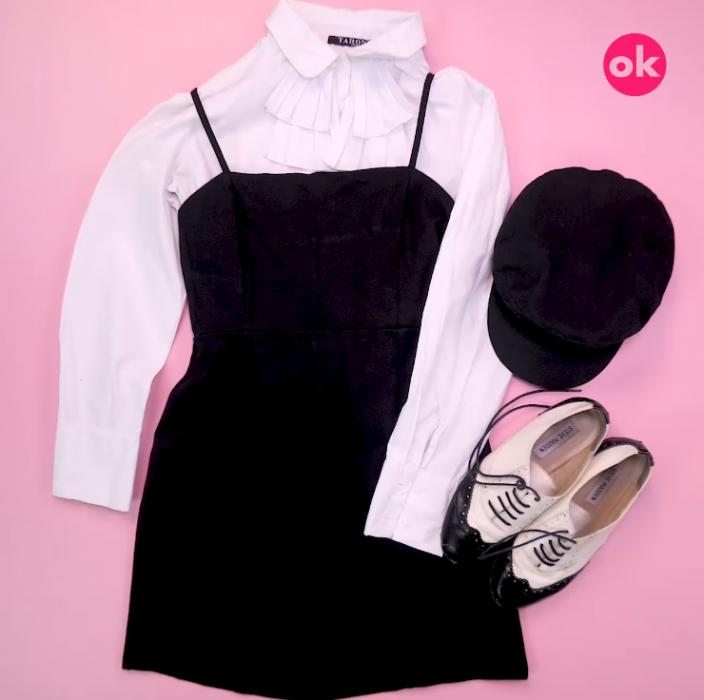 vestido negro con camisa blanca zapatos blancos y boina negra