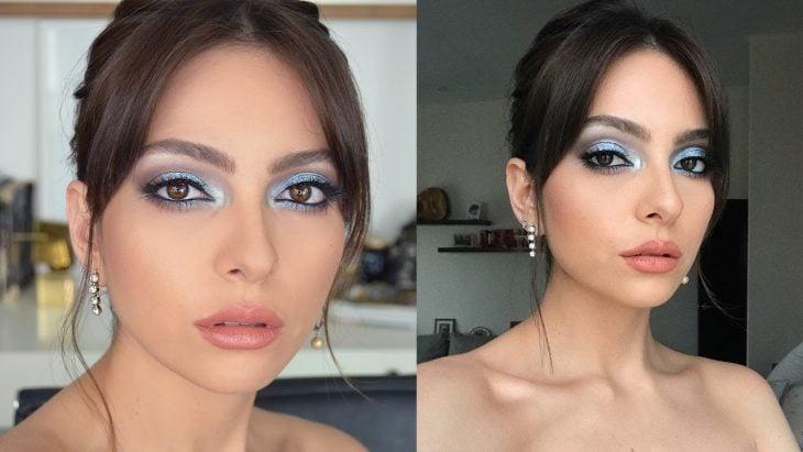 mujer con maquillaje de ojos azul cielo