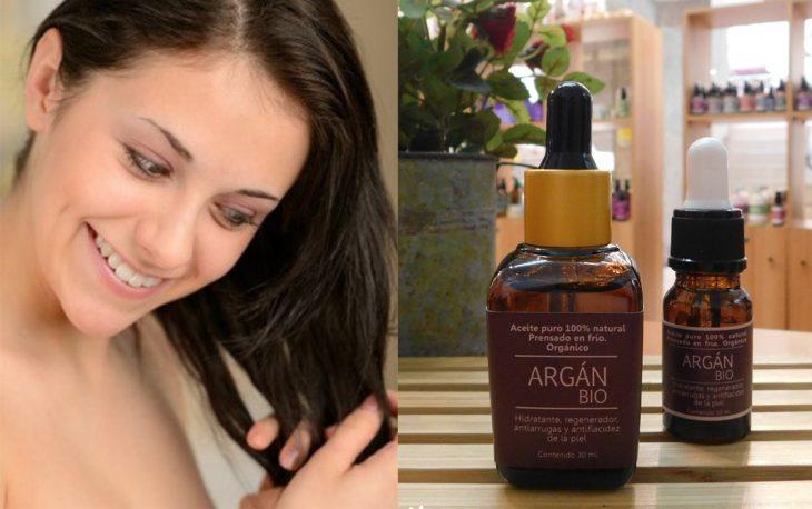 mujer aplicando aceite en sus puntas del cabello