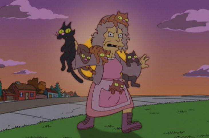 Mujer loca de los gatos
