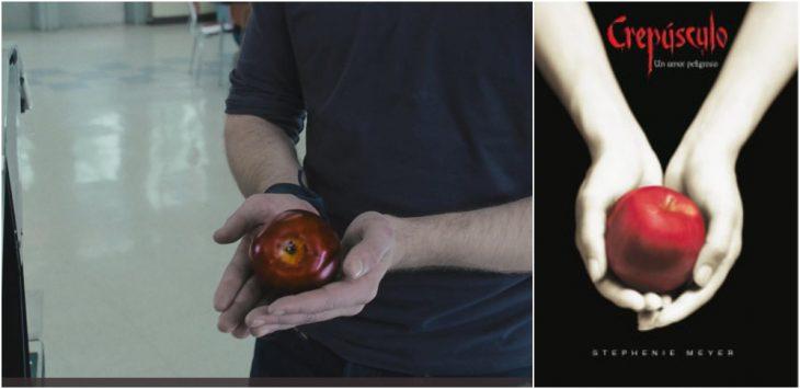 chico sosteniendo una manzana