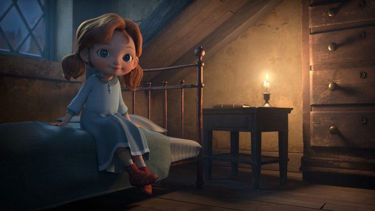Niña de coletas con vestido azul y botas rojas sentada en la cama