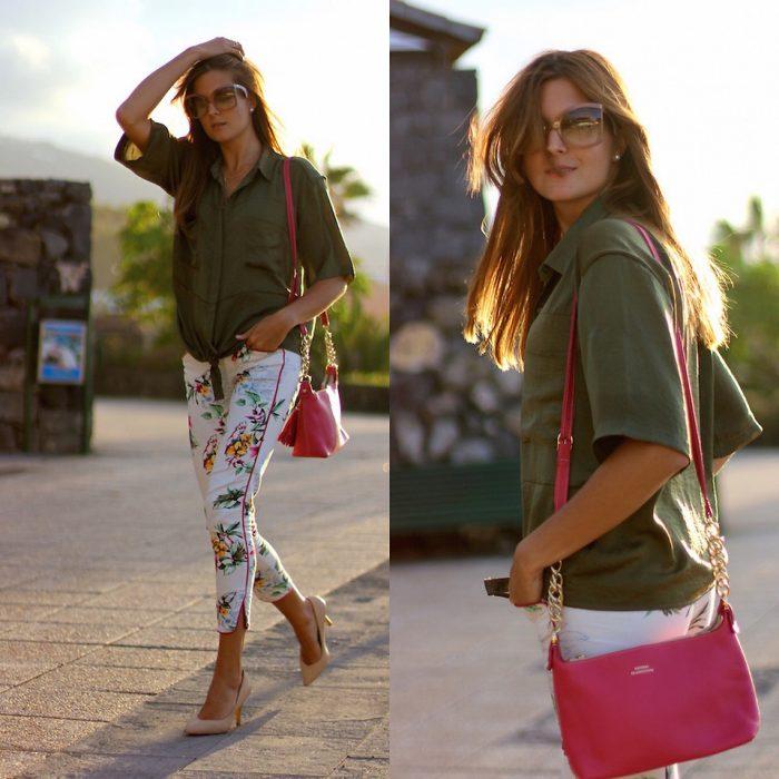 mujer con camisa verde y pantalón blanco con bolsa rosa