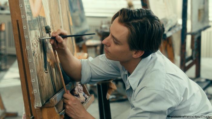 chico pintando en oleo