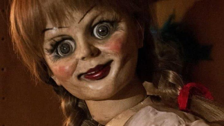 muñeca de madera pintada