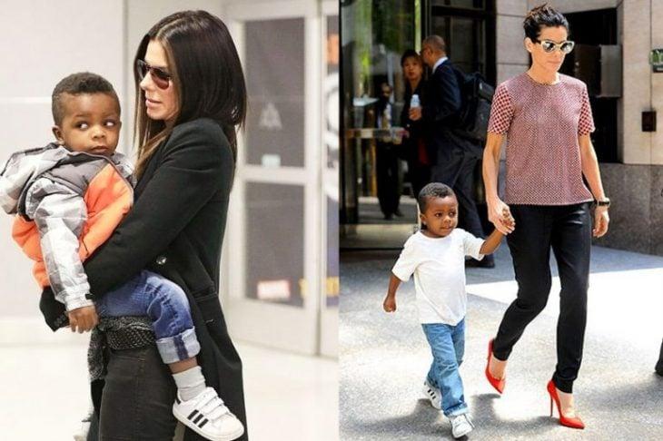 mujer con cabello negro y lentes cargando a niño
