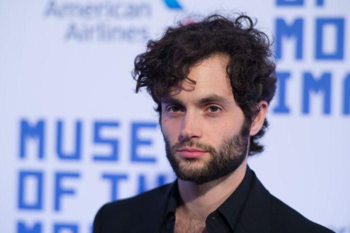 hombre con barba y cabello rizado