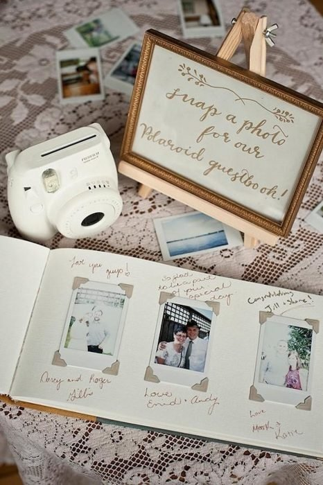libro de fotos con cámara y frases