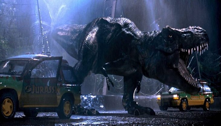 dinosaurio atacando a un depredador