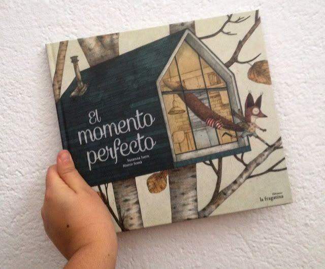 niño sosteniendo un libro infantil El momento perfecto