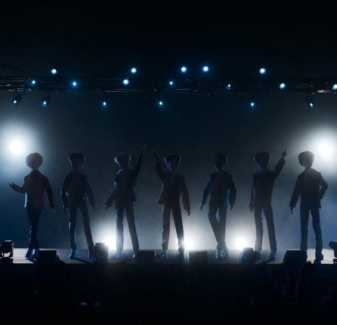 Muñecos de Mattel inspirados en el grupo de K-pop BTS parados sobre un escenario e iluminados por luces de color azul