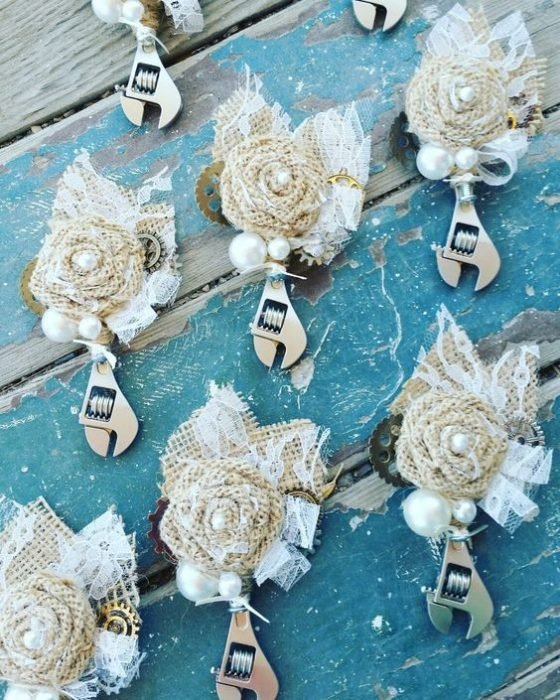 Pressure wrenches decorated with white flowers as reminders for a biker style wedding