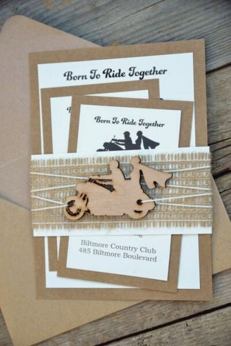 Wedding invitations with design of motorcycles in coffee color with decorated in bows for a wedding biker