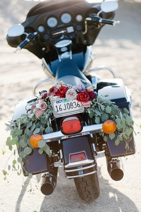 Motorcycle decorated with flowers for a wedding with biker style