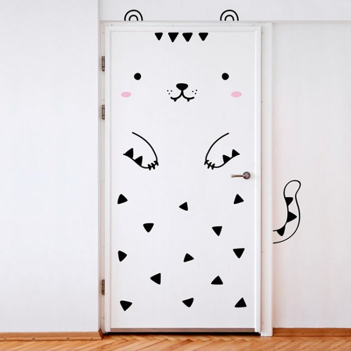 Door of a room decorated with a kitty vinyl