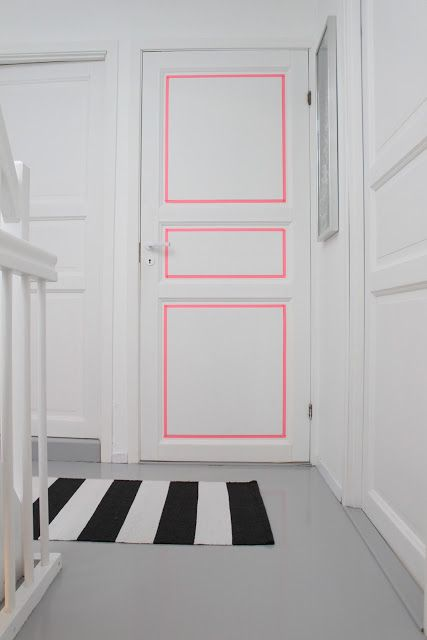 White door decorated with pink lines in the paintings that form it