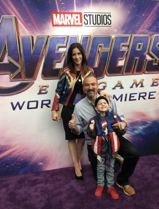 Felipe Andres Muyshondt disguised as Captain America, his mother with a jacket of Captain Marvel and his dad at the world premiere of Avengers: Endgame with Chris Evans