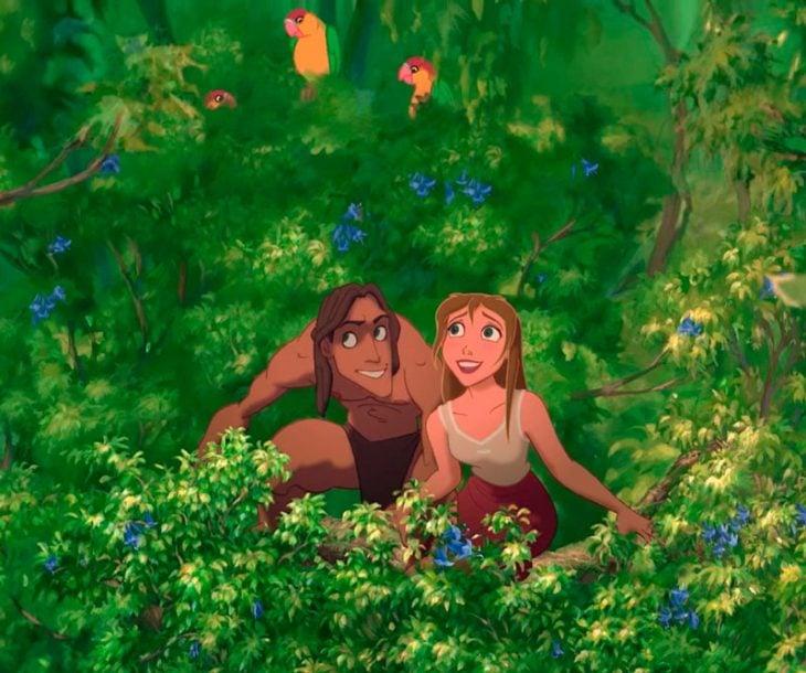 Dibujo animado de Jane y Tarzán en medio de la selva viendo aves volar, escena de la película Tarzán