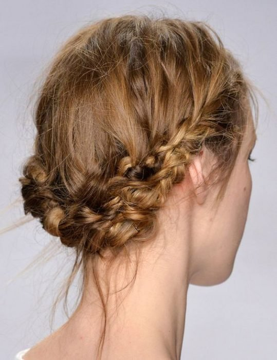 Redhead girl with braid hairstyle messy style