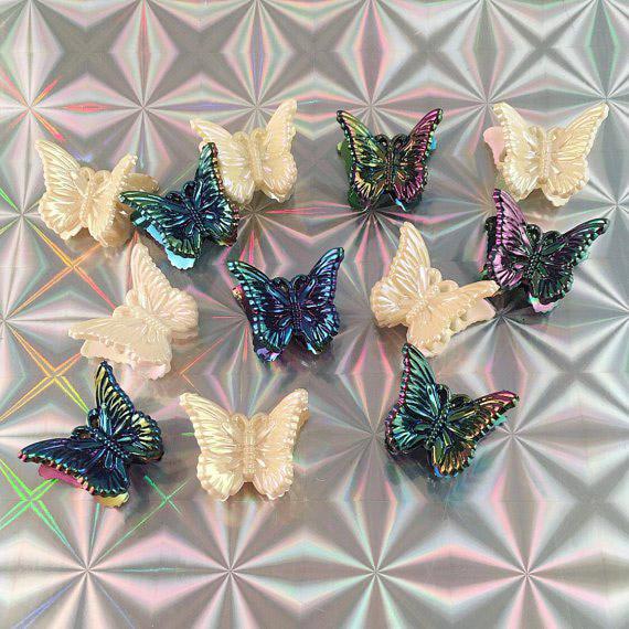 Pinzas de mariposas con tonalidades tornasol y blancas para el cabello