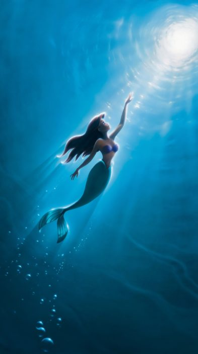 Wallpaper for Disney cell phone;  Ariel wallpaper from the movie The Little Mermaid swimming to the surface of the sea