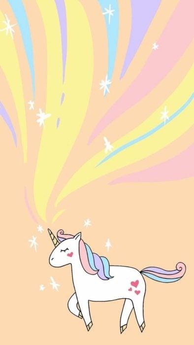 Fondo de pantalla para celular con el dibujo de un unicornio al que le sobresale un arcoirís de su cuerno